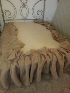 DIY Burlap Bedskirt--All you need is burlap (purchased at a fabric store) and upholstery pins to secure to the box spring.  Easy!