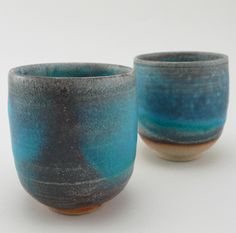 Tsuji Yoshiko creates vessels through a glaze technique where the ash from a local wood with which the kiln is fired melts onto the piece itself. Each cup is wheel thrown gracefully thin, and finished with a turquoise brilliance