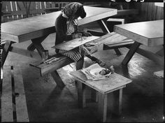 PRINT AVAILABLE   San Bruno, California. An art school wall has been established in this Assembly center with large enrollment and a well trained, experienced Japanese staff under the leadership of Professor Chiura Obata of the University of California. This photograph shows a student in Still Life class painting a free water color.