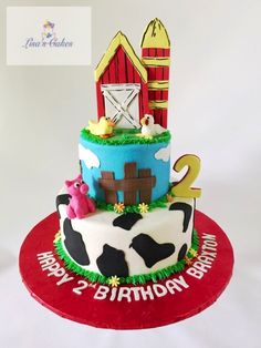 Buttercream iced Farm themed birthday cake.  Topper made out of gumpaste and animals out of modeling chocolate