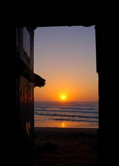 Sunset through the doorway of the R'bat surf grotto by Peace Correspondent on Flickr.
