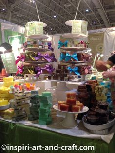 Colorful soap displayed on cake stands