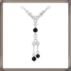 white gold necklace set with diamonds, rubellites, onyx