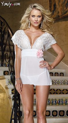 http://shrsl.com/?~3bmb White, stretch mesh babydoll with lace sleeves and cups, pink organza flower detail, open back and matching thong. Sale Price:    $33.95 BUY NOW at http://shrsl.com/?~3bmb