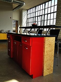Upcycled 50's metal kitchen cabinet into a kitchen island.  By Rande Hackmann/Architectural Elements