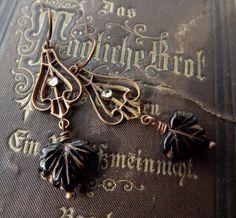 Art Nouveau dangle earrings, vintage brass scrollwork with black glass leaves