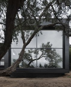 Cool flat roof cabin in black. Thank you Finland!