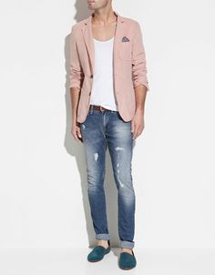 Salmon pink blazer rocked with a pair of distressed jean and emerald green slipper.  For a dapper finish - a pocket square. Enough said.