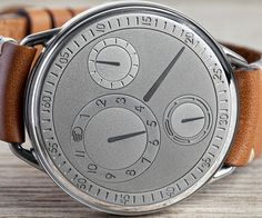 Ressence marks the 5thanniversary of its no-hands, no-crownsystem with a limitededition of its first model. The Type 1 V Genesis has a sandblasted nickel silver dial, a titanium case and a curved sapphire crystal cover.