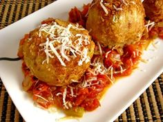 """Arancini di Riso: """"Rice Balls"""" (* leftover risotto, * mozzarella cheese cut into cubes, 1 egg (lightly beaten), 1/4 cup parmigiano reggiano (grated), 1 cup bread crumbs, vegetable oil for frying, and * leftover marinara sauce)"""