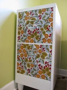 Fabric drawer covers (mod podge), paint, & wood feet = not-so-ugly file cabinet!