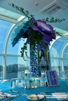 A garden Bat Mitzvah with unique centerpieces. These amazing flowers are made of paper.|Dalsimer Atlas Floral and Event Decorators