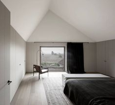 Bedroom space with chalky neutrals, pale wooden floors, darker grey cupboard and black linen | Detail Collective | Share the Love | Vincent Van Duysen | Image: via Vincent Van Duysen