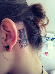 behind the ear owl tattoo