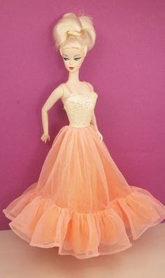This dress is the epitome of Peaches N Cream! Gorgeous with iridescent textured…