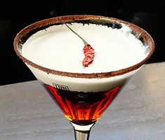 RED HOT SANTA-TINI  1. Rim a martini glass with cocoa powder with a pinch of cayenne pepper added.  2. Shake together 2 oz. Mazama vodka and 2 oz. Godiva chocolate liqueur and pour into glass.  3. Top with 1 1/2 oz. sweetened whipped cream.  4. Garnish the cream with a small Thai chili pepper.