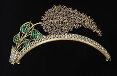 19th century frontlet or tiara, made of gilt metal and decorated with coloured pastes in the shape of a spray of lilac.