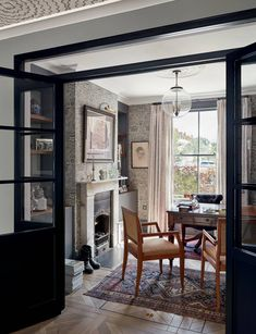 West London house designed by Nicholas Spencer and Sophie Wedekind   House & Garden Shaker Kitchen Cabinets, Rattan Coffee Table, French Windows, Lets Stay Home, London House, English House, West London, Decor Interior Design, Home And Family