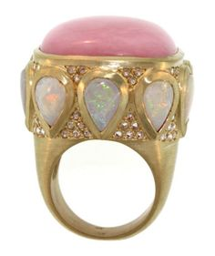A Stunning piece, this large pink opal ring is accented by pear shape opal cabochons and sparkly rose cut diamonds. 5.10 ctw in diamonds, opal carat weight is 20.24.
