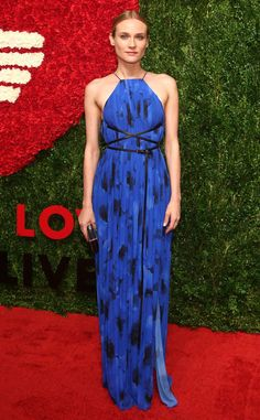 Diane Kruger from The Best of the Red Carpet  Diane's red carpet winning streak continues with this poppy print Michael Kors gown andstudded clutch.