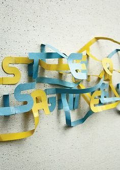"This last piece is effective at drawing attention because it visits the idea of mixing mediums somewhat. Typography is thought of as flat, but this uses 3D materials to give the letters more form, making them more interesting. The colors are also attractive and their ""lines"" create a sense of movement."