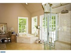 master bathroom - love everything except the clear glass shower (prefer opaque) and the door to the outside. What if someone breaks in? They're going to head straight to your bedroom.