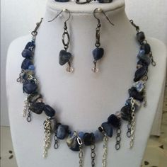 Handmade blue and gray stone set. This three-piece set is made with natural blue and gray stones. Chains of various shapes and sizes are added for texture. Jewelry Necklaces