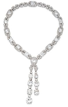 A MAGNIFICENT PLATINUM AND DIAMOND SAUTOIR NECKLACE WITH LAVALLIERE PENDANT, CARTIER, NEW YORK, 1924