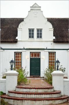 Beautiful Cape (South African) Dutch gable dated 1855 on Basse Provence manor house South African Homes, African House, Roof Styles, House Styles, Gable Wall, Cape Dutch, Dutch House, Arched Doors, Architectural Features