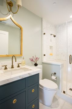 bathroom // blue vanity // brass hardware // marble tile // Fiorella Design