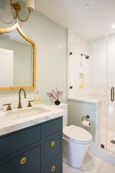 bathroom // blue vanity // brass hardware // marble tile // Fiorella Design