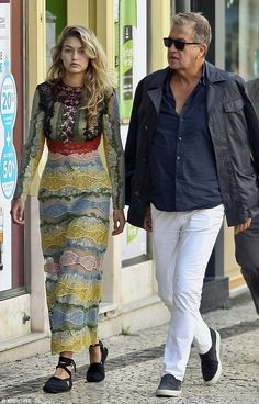 It's a hard job but somebody's got to do it: Gigi Hadid was spotted working two different stylish outfits for a photoshoot with Mario Testino  in Porto, Portugal, on Thursday