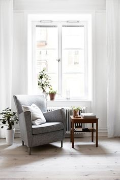 chair by the window with plants