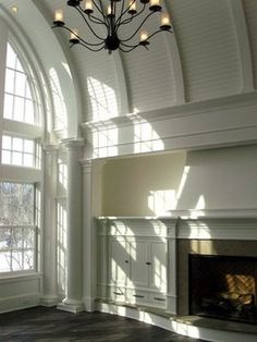 fireplace wall - curved hearth - beadboard barrel vaulted ceiling