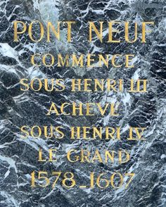 This marble plaque is found on the oldest bridge in Paris - the Pont Neuf with golden inscribed information.  See more www.eutouring.com/images_pont_neuf.html