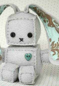 Just add ears to that other free robot plush DIY sewing pAttern I already pinned! Robot Easter bunny For the boys baskets!