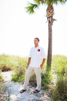 Love this groom and groomsmen outfit, it's so casual and perfect for a beach wedding. Flip flops and khakis are perfect! wedding groom attire khakis Romantic Destination Wedding at the Sirata Beach Resort Groom And Groomsmen Outfits, Casual Groom Attire, Casual Grooms, Mens Casual Wedding Attire, Casual Bride, Groom Outfit, Groomsmen Beach Attire, Groom Suits, Beach Wedding Groom Attire