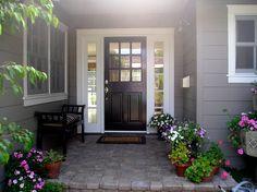 black front door, white trim around side windows