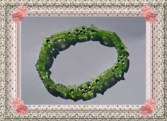 """This """"One Made Only"""" Green Bracelet Would Suit The Females Who Have Green Thumbs And Love Nature!  This Green Thumbs Bracelet Has A Twist Of Jazz Added to It To Make It Look Stunning!  This Piece Will Not Last Long So HURRY And Purchase It Now Before It's To Late And It's Gone For Good.  It Can Be Yours Now For Only $5.00USD -  Shipping Extra!  Yes We Ship World Wide!!!!"""
