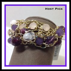 """Shades of Purple Bracelet Stretchy bracelet with various shades of purple beads and gold chains. Looks like you are wearing several bracelets. Great for day or night. Approx. 2 1/4"""" diameter  Trades  Holds Erica Lyons Jewelry Bracelets"""