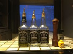 Reuse old jack Daniels bottles for oil.