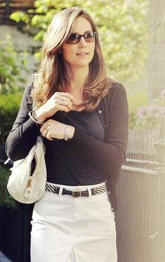 Duchess Catherine in black top, black cardigan, white skirt, and white Prada bag, May 2007
