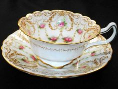 Royal doulton antique pink roses white curvy tea cup and saucer