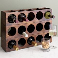 I've been compiling a list of the best new wine racks for the past two years, and this year I thought I'd do something a little different and highlight vintage designs (in addition to an expanded list of new and easily available racks). Some of these older pieces are no longer in production and you have to hunt for them, but it's a thrill when you find the perfect piece. Here's a mix of vintage, new, and DIY options — Enjoy!