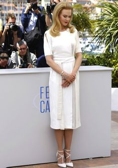 Nicole Kidman in a white Altuzarra's Fall 2014 crepe dress with white Elie Saab pumps #celebritystyle #cannes