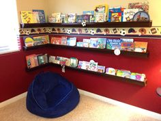 Son's reading corner using brown vinyl rain gutters from Home Depot. He can see all the covers and reach each shelf himself. All for under $75. The end caps and corner pieces were the most expensive part of this project, but still less than the cost of a bookcase.