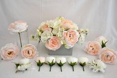 Bridal table arrangement of peach,coral, pale pink and off white peonies, roses, hydrangea and sweet pea. So pretty and soft. #justfakeitbouquets #silkpeonies #bridalflowers #arrangement #peach