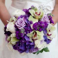 A lush arrangement of green orchids, roses and purple hydrangeas. {from the album: A Regal Spring Wedding in Durham, NC}