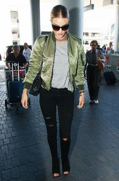 Rosie Huntington-Whiteley's look costs over $7807.  On Huntington-Whiteley: Saint Laurent Shell Bomber Jacket; Isabel Marant T-shirt; Paige Denim Verdugo Ankle Jean; Saint Laurent Monogram College Chain Tote Bag and Punk Gourmette Chain-Link Choker; Gianvito Rossi Open-Toe Wedge Sandal Booties in Black.