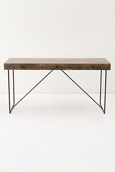 I LOVE reclaimed wood. We bought our kitchen table for the new place in reclaimed wood and then put super modern chairs with it. Likin' that look.